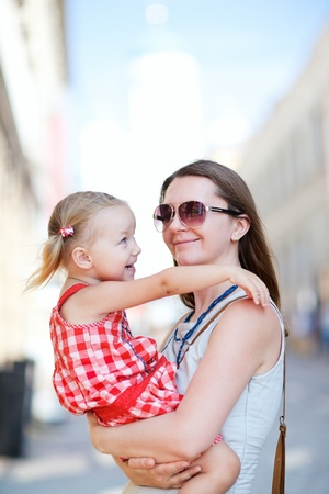 Mother and her little daughter outdoors in city Stock Photo - 9978501