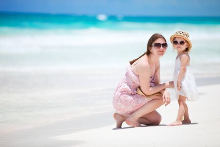 Mother and her little daughter enjoying Caribbean beach vacation Stock Photo - 9978513