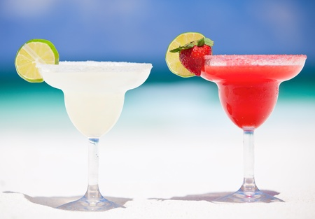 caribbean drink: Classic and strawberry margarita cocktails at exotic Mexican beach