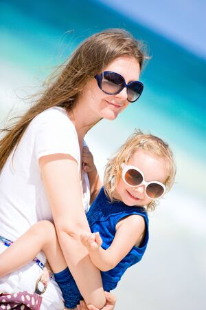 Young mother and her little daughter on tropical vacation photo