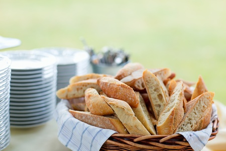 Bread and stack of plates for group catering photo