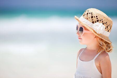 Portrait of adorable little girl wearing elegant hat Stock Photo