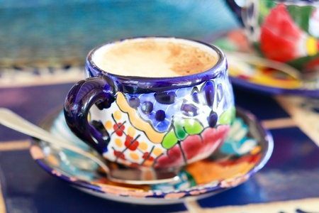 pottery: Cappuccino in traditional colorful mexican pottery cup Stock Photo