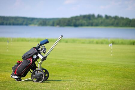Golf clubs in bag on a golf course field Stock Photo