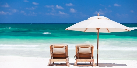 Two chairs and umbrella on stunning tropical beach in Tulum, Mexico Stock Photo - 10084276