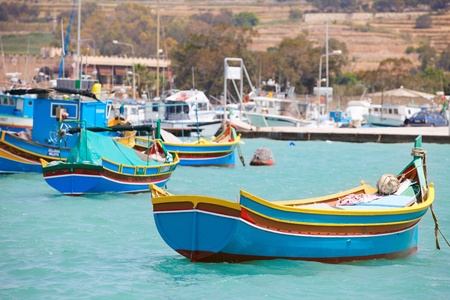 Marsaxlokk village and traditional colorful boats in Malta photo