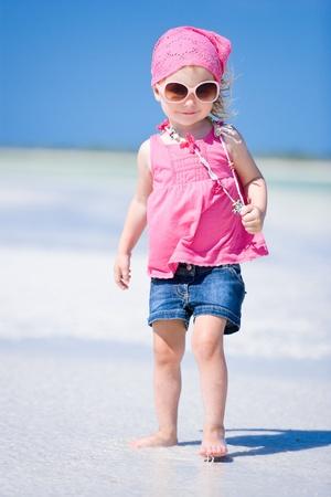 seashores: Portrait of adorable little girl at tropical beach Stock Photo