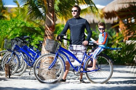 Father and son riding a bike together Stock Photo - 10200836