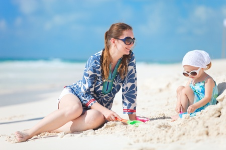 Mother and her little daughter enjoying Caribbean beach vacation Stock Photo - 10274575