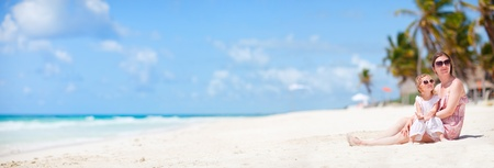 panoramic beach: Mother and her little daughter enjoying Caribbean beach vacation Stock Photo