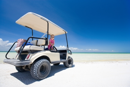 exotic car: Golf cart at tropical white sand beach in Holbox Mexico