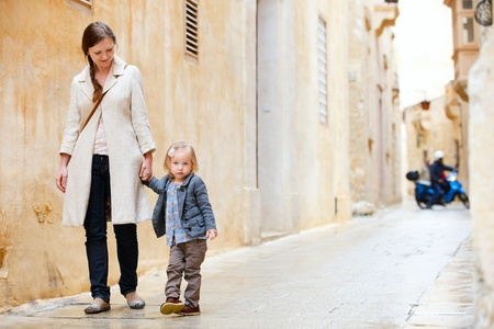 Mother and her little daughter outdoors in city Stock Photo - 10345072