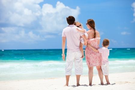 Family of four on Caribbean beach vacation photo
