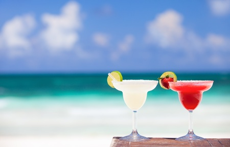 Classic and strawberry margarita cocktails at Mexican beach