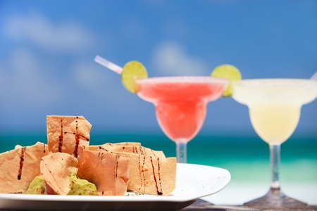 Traditional mexican tortilla chips and margarita cocktails photo