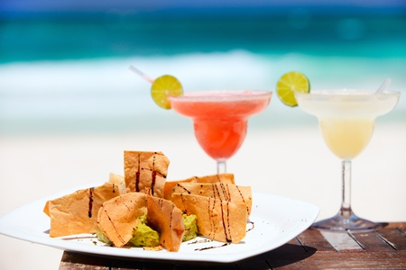 Traditional mexican tortilla chips and margarita cocktails