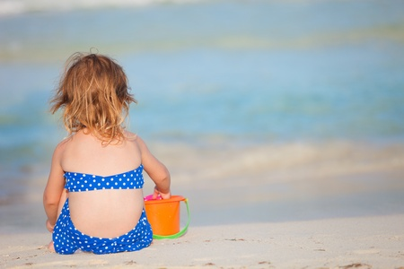 beach toys: Adorable little girl playing with toys at tropical beach Stock Photo