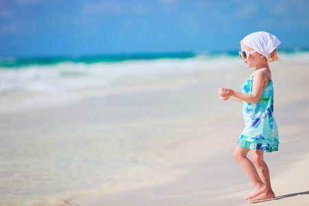 tulum: Little playful girl at Caribbean beach Stock Photo