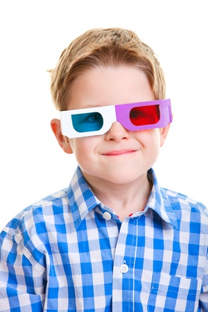 Cute little boy wearing 3D glasses isolated over white photo