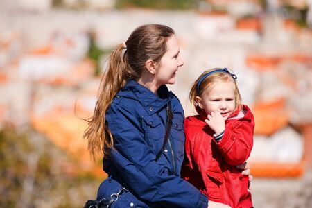 Mother and daughter outdoors portrait on sunny autumn day Stock Photo - 11399362