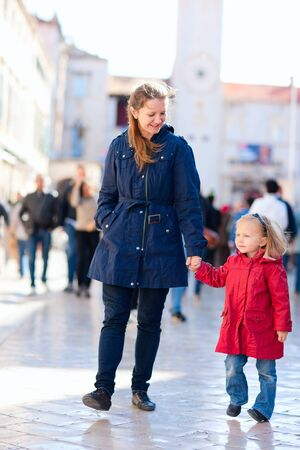 Mother and her little daughter walking in city Stock Photo - 11399344