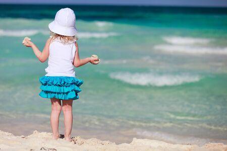 little girl beach: Back view of  little girl at tropical beach