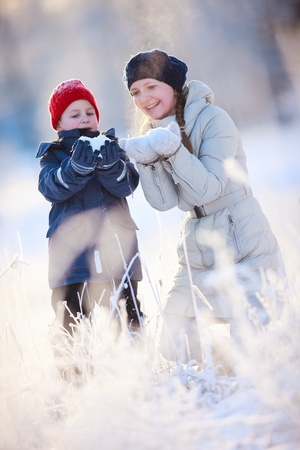 Mother and son enjoying beautiful winter day outdoors photo