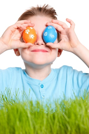 Funny portrait of happy boy playing with Easter eggs photo