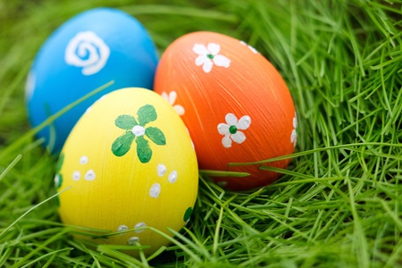 Three Easter eggs in a fresh green grass photo