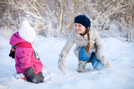 Young mother and her little daughter outdoors on winter day Stock Photo - 12420165