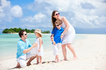 Young beautiful family with two kids on tropical vacation Stock Photo - 12882459