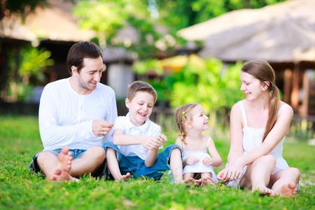 Portrait of happy beautiful family outdoors on summer day photo