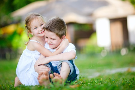 Adorable happy kids outdoors on summer day photo