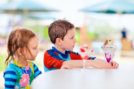 Two little adorable kids eating ice cream Stock Photo - 12882503
