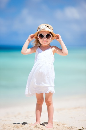 Adorable little girl at tropical white sand beach Stock Photo - 12981685