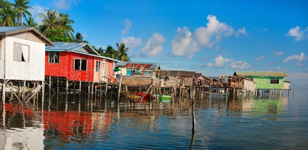 house float on water: Panorama of traditional sea gypsy village at Kalapuan island in Malaysia