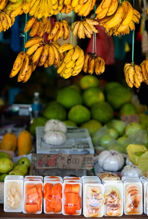Market stall with bananas and other fruits photo