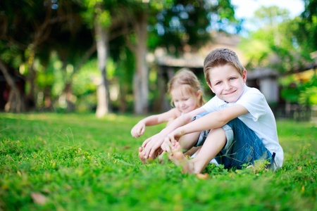 brother and sister: Brother and sister outdoors on summer day Stock Photo