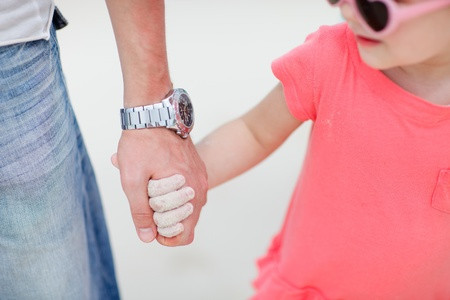 Close up of father and daughter holding hands Stock Photo - 13587252