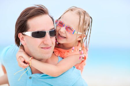Portrait of happy father and his sweet little daughter at beach Stock Photo - 13653361