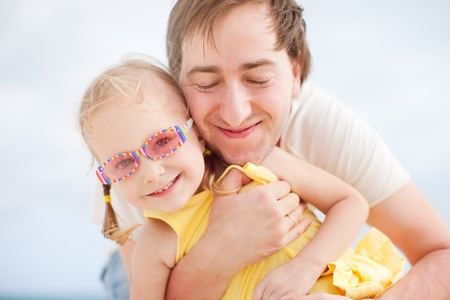 Portrait of happy father and his adorable little daughter photo