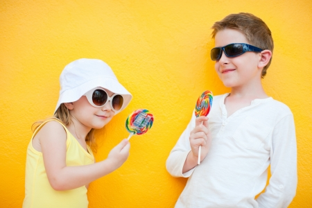 Adorable little kids with colorful lollipops photo
