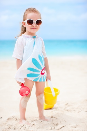 Adorable little girl with beach toys on vacation Stock Photo - 13709453