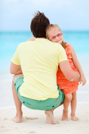 Father and his adorable little daughter at tropical beach photo