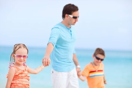 Portrait of happy family enjoying beach vacation photo