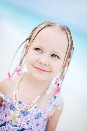 Portrait of adorable little girl at beach photo