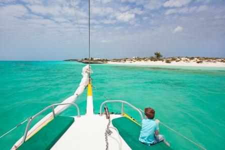Little boy enjoying ride on a luxury yacht Stock Photo - 14157337