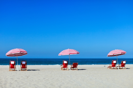 Three sun umbrellas at Santa Monica beach photo