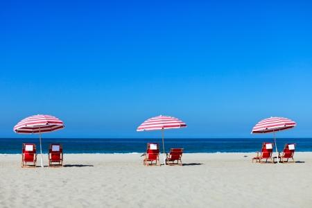 california beach: Three sun umbrellas at Santa Monica beach