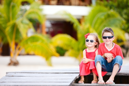 Brother and sister outdoors at tropical destination